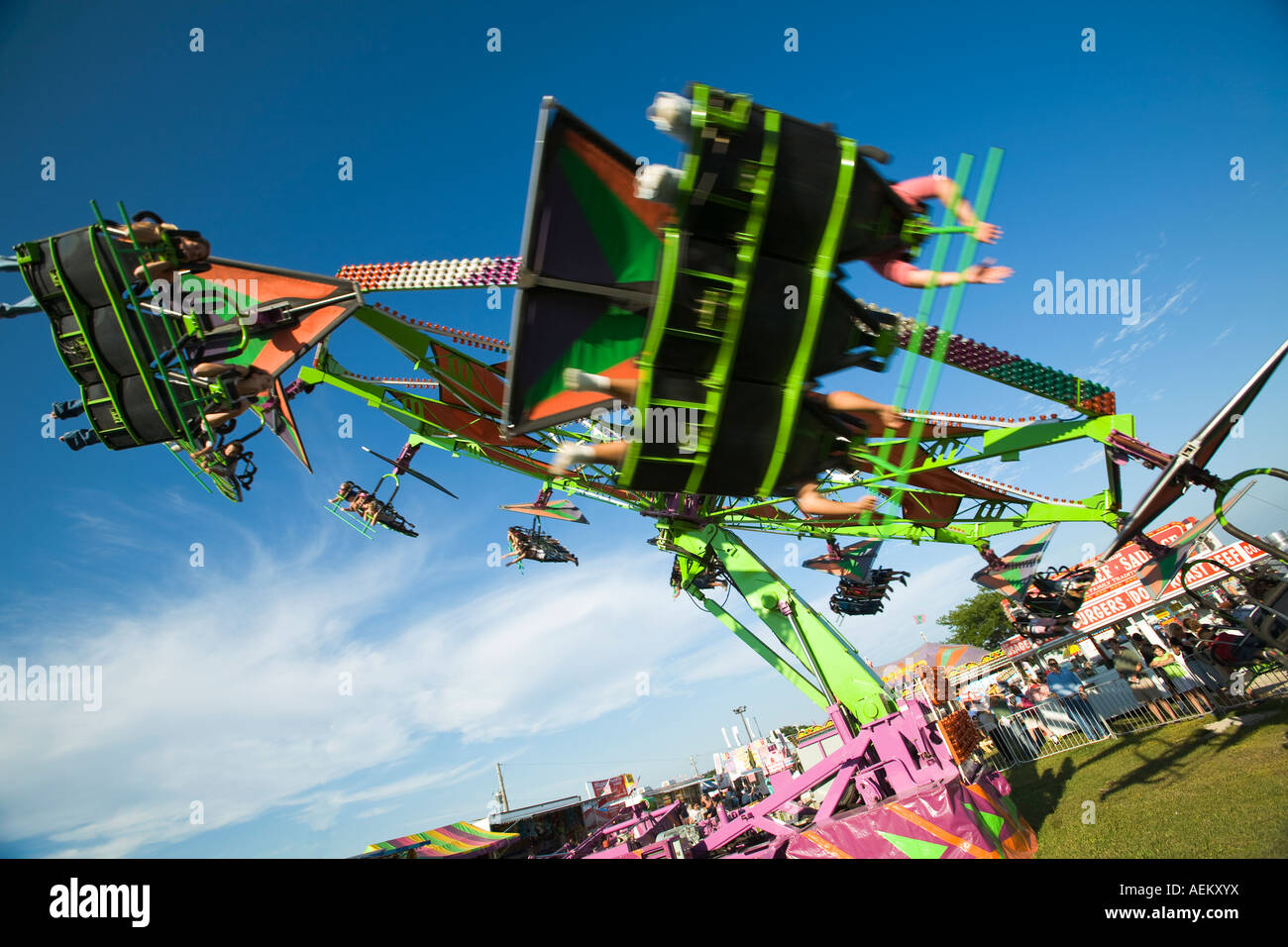 ILLINOIS Grayslake Riders lie on stomachs in amusement ride at Lake County Fair fly in circle - Stock Image