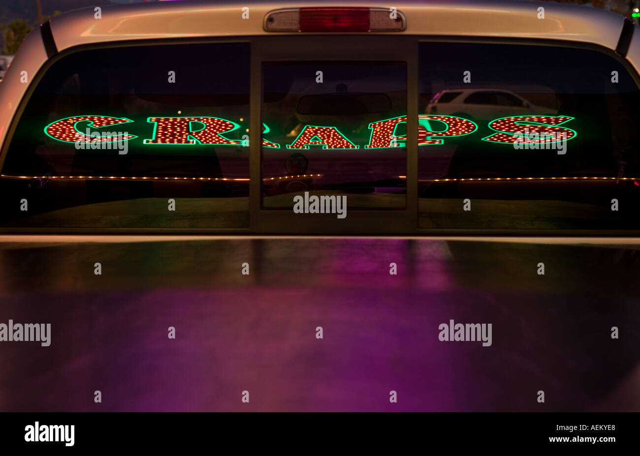 Reflection of a casino craps neon sign reflected in truck window Virgin River Hotel Casino Mesquite Nevada - Stock Image