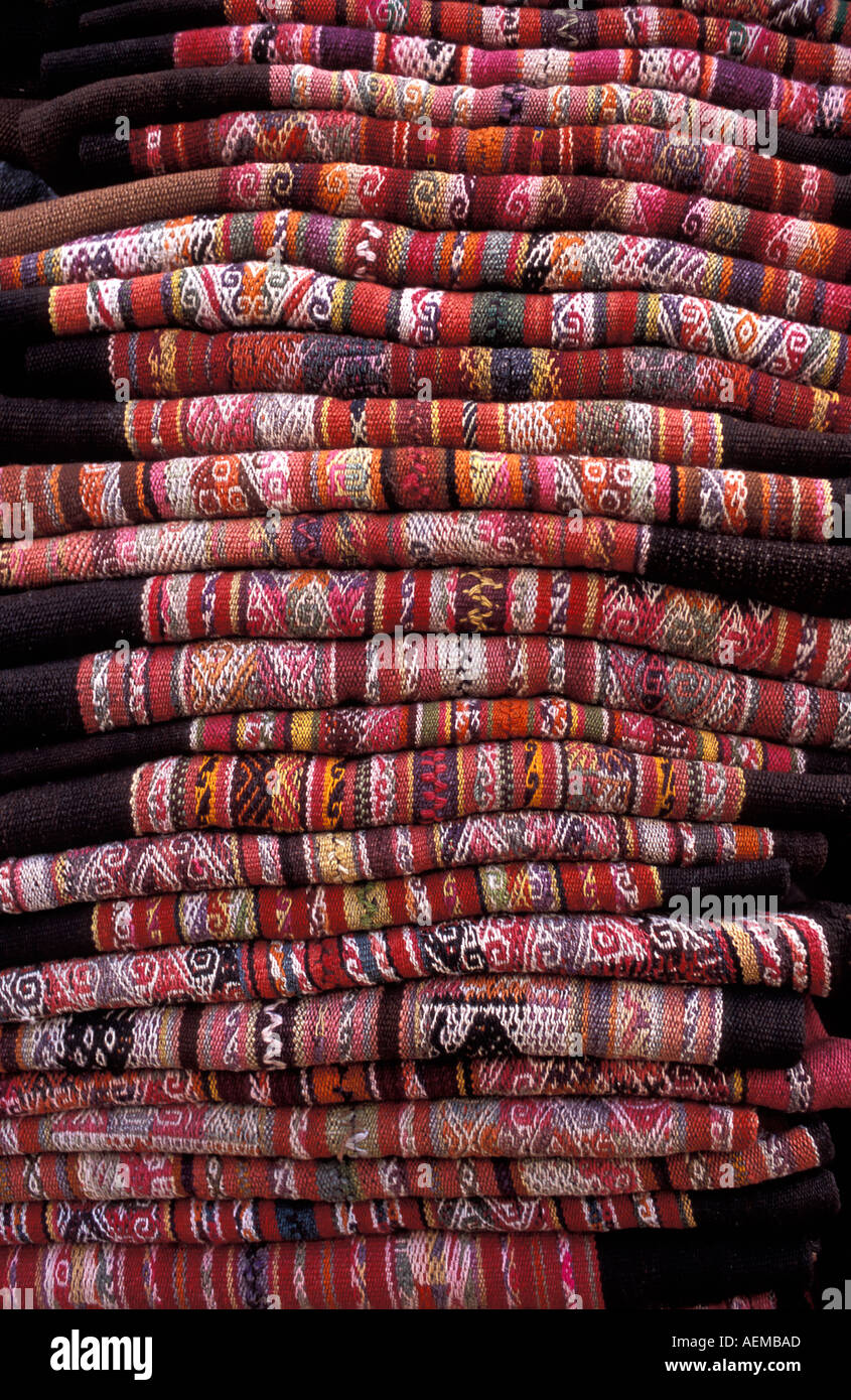 A stack of Bolivian woven woollen textiles as sold in markets of La Paz Sucre Tarabuco and Potosi Bolivia South Stock Photo