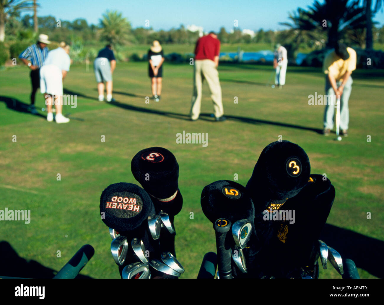 Golf Rackets With Tourists Playing In The Background At The Golf Stock Photo Alamy