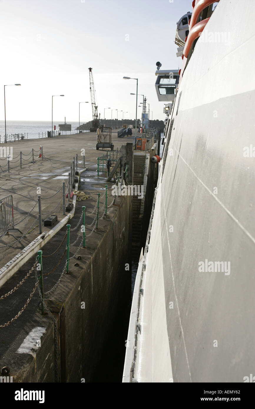 Side of super sea cat fast ferry tied up against the harbour douglas isle of man IOM - Stock Image