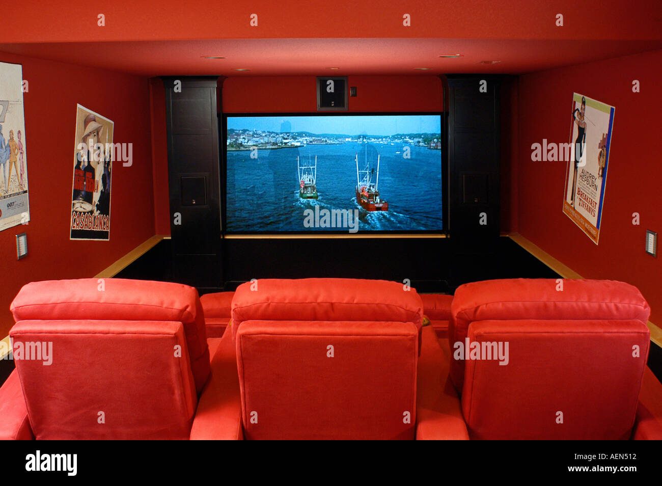 Luxury Home Movie Theater And Screen Red Recliner Chairs.   Stock Image