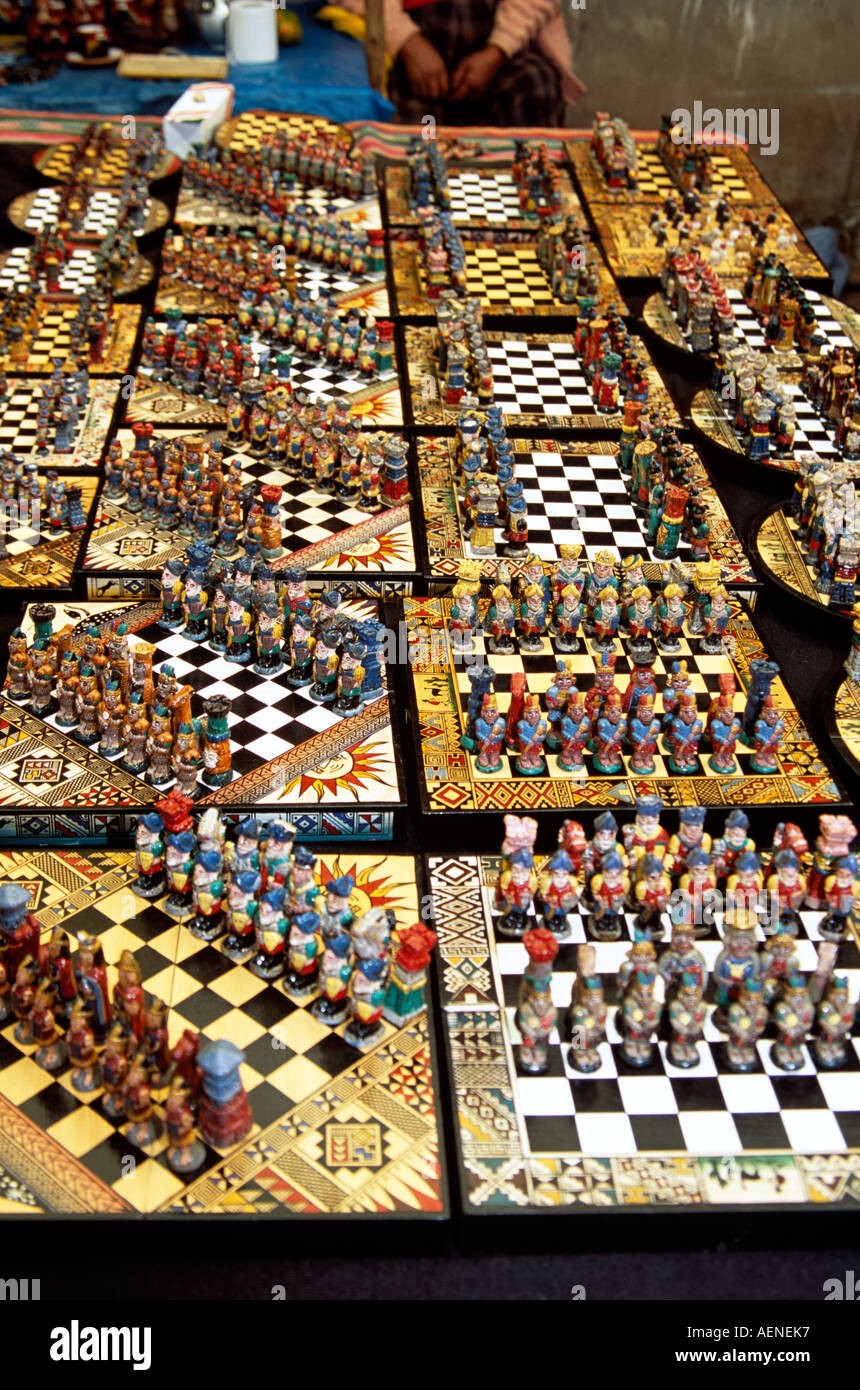 Colourful unusual chess sets on stall, Pisac Market, Pisac, near Cusco, Peru - Stock Image