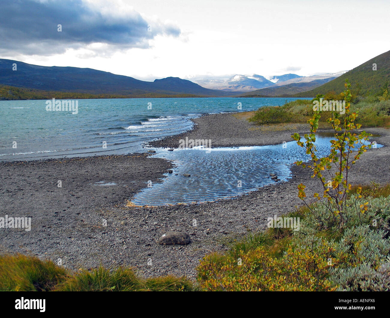 Lake on valdresflya during turning of the seasons / Indian summer, Valdresflya, Jotunheimen, Norway - Stock Image