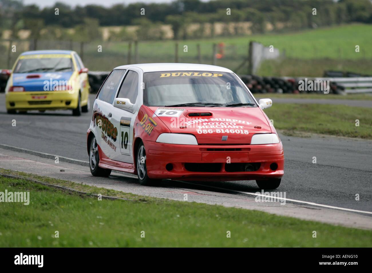 Fiat Uno Punto racing at Kirkistown Circuit county down Northern Ireland -  Stock Image