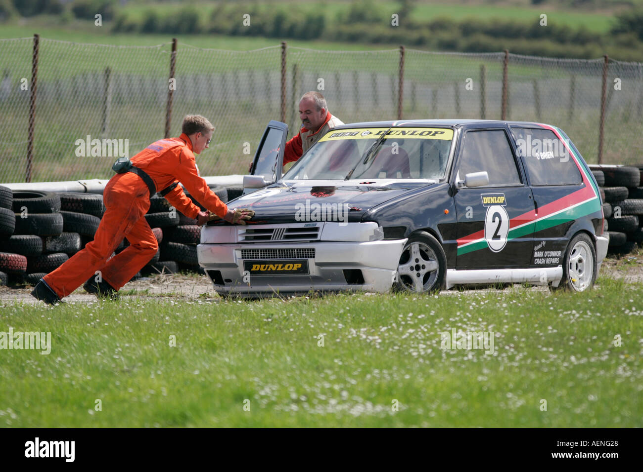 Marshall pushes crashed Fiat Uno at Kirkistown Circuit county down Northern Ireland - Stock Image
