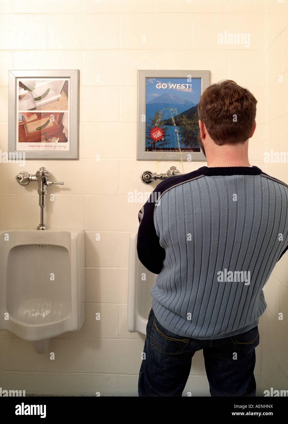 Man Using Urinal Stock Photo 13725973