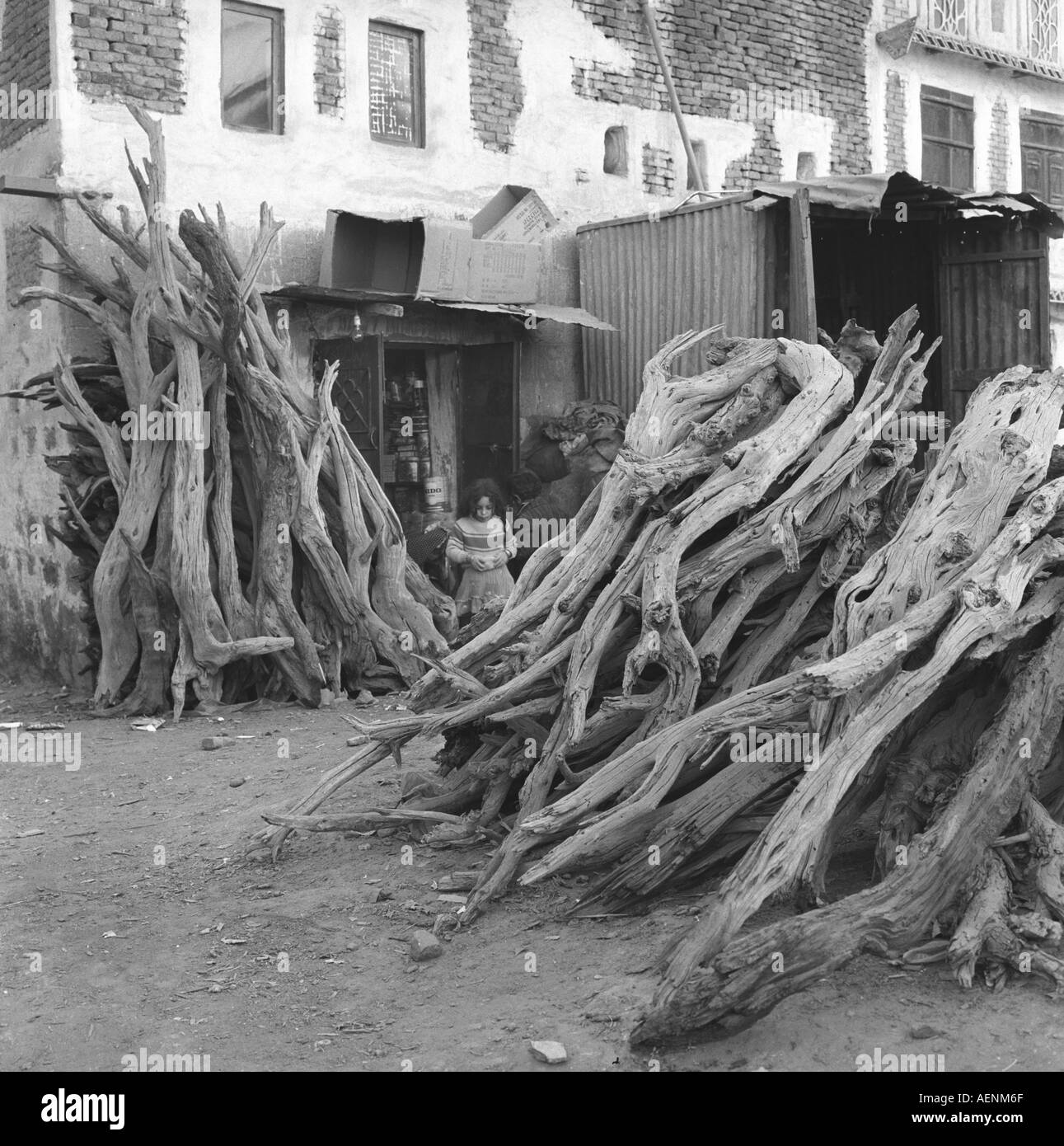 Market scene with firewood Sanaa Yemen Arab Republic - Stock Image
