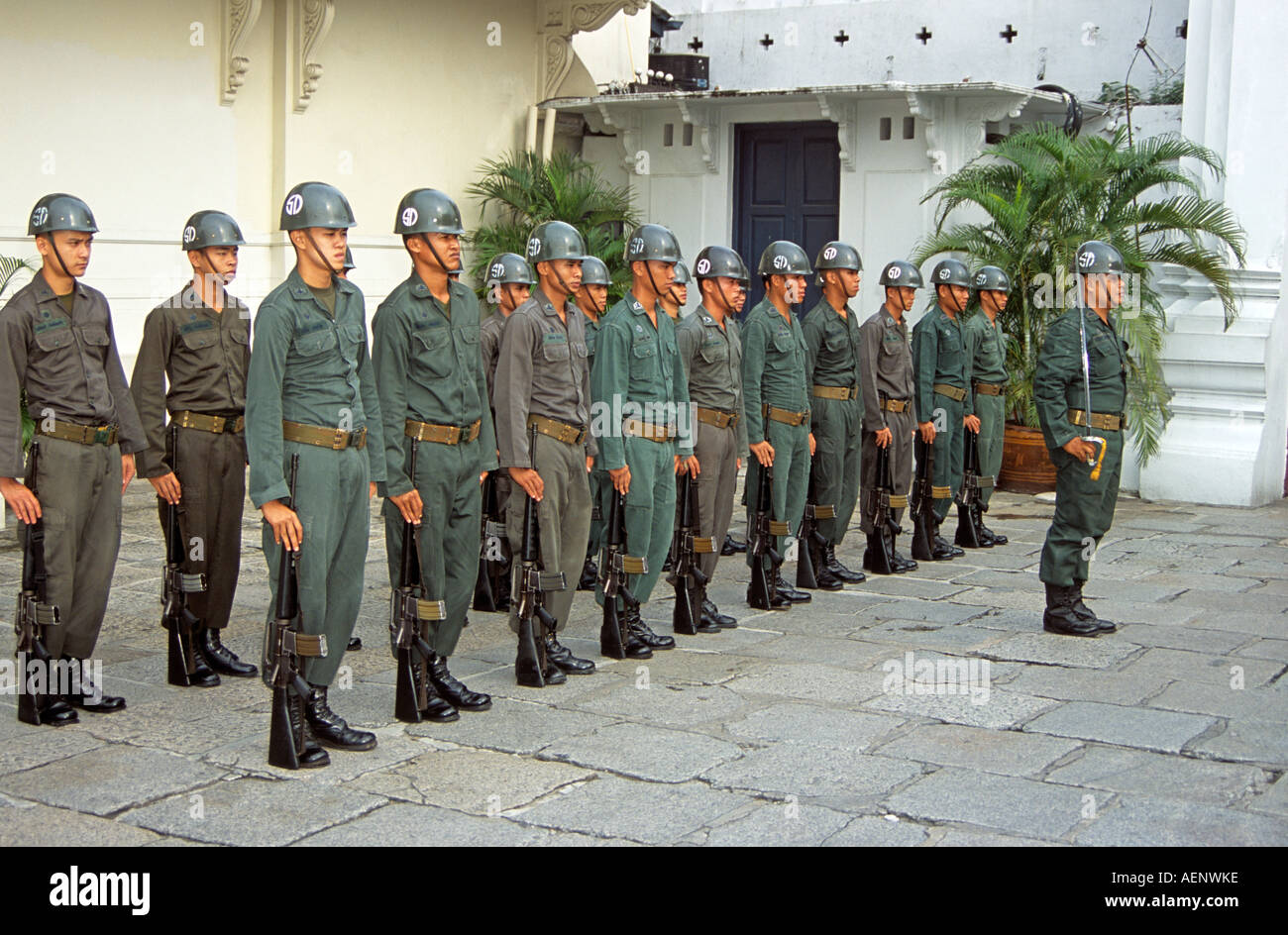 Soldiers standing to attention during changing of the guard, Grand Palace, Bangkok, Thailand Stock Photo