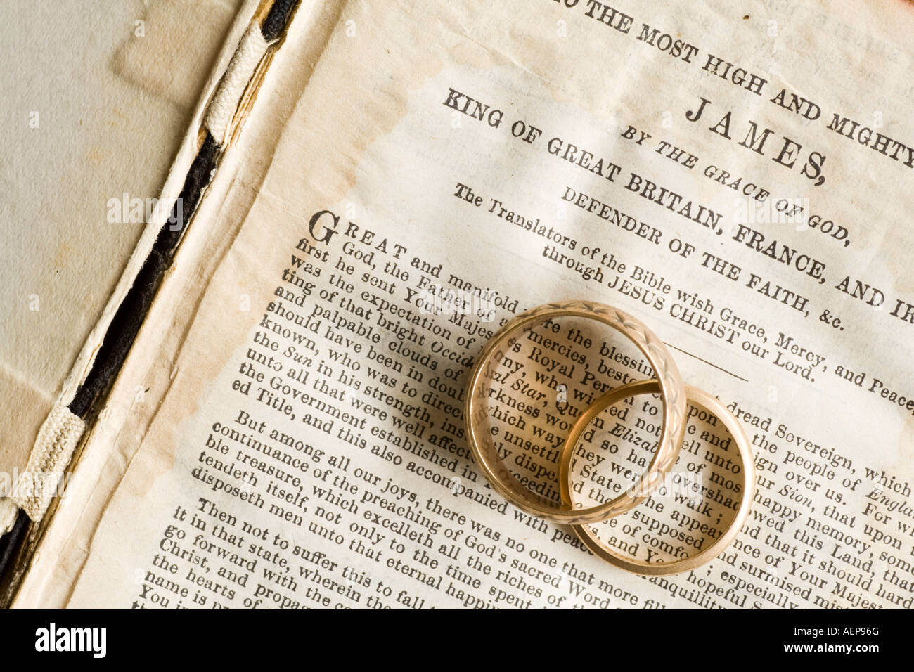 bible and two gold wedding rings stock photo 13732503 alamy