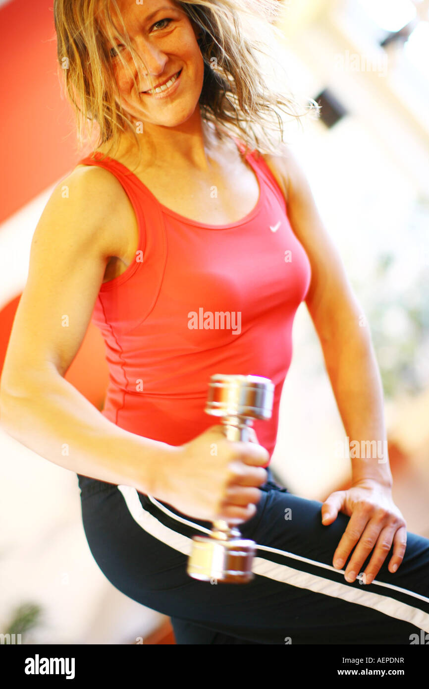 Junge Frau mit Hantel , Woman with a dumbbell - Stock Image