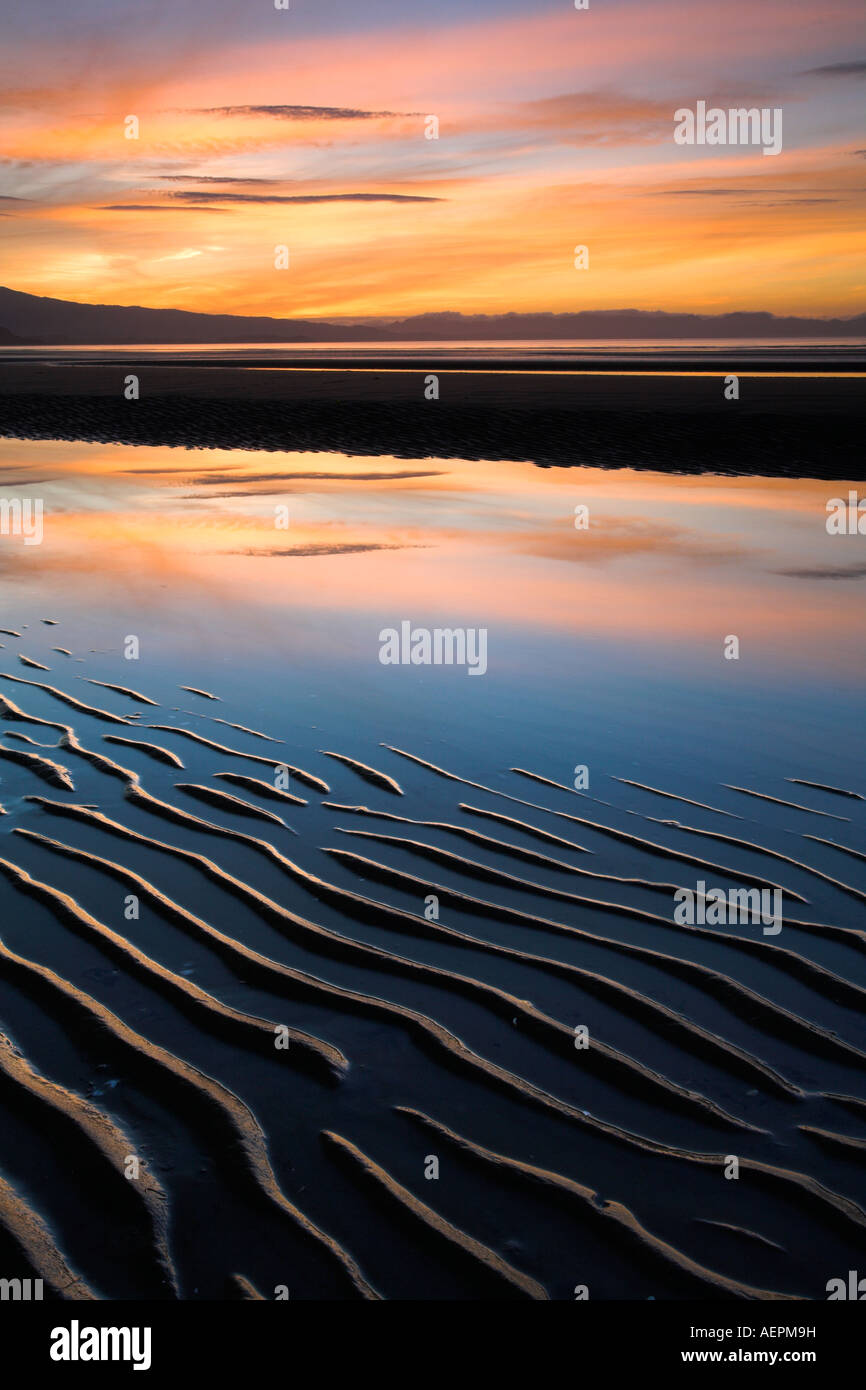 Sunset and sand ripples on Pohara Beach in Golden Bay, New Zealand - Stock Image