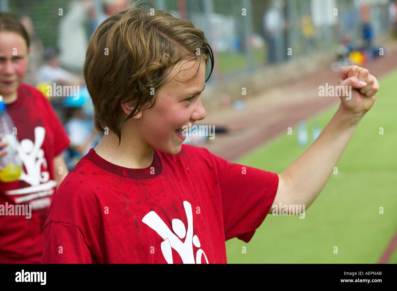 young girl cheering on her team mates at a hockey match - Stock Image