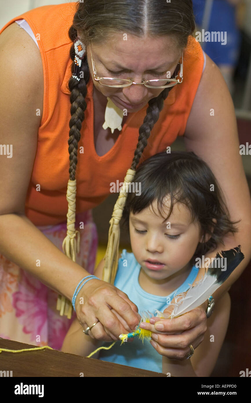 Child Makes Talking Feather at Peace Camp - Stock Image