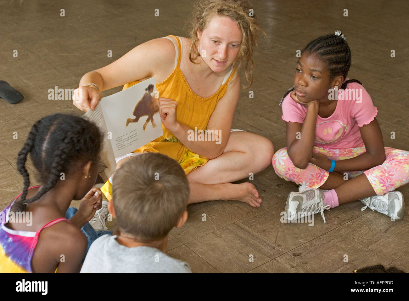 Children Listen to Story at Peace Camp - Stock Image