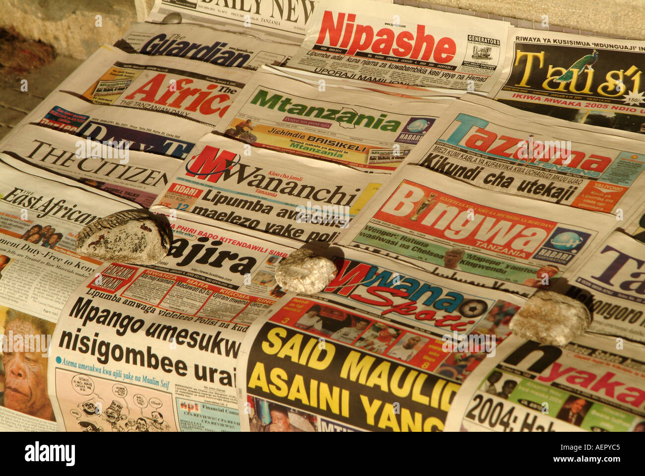 English and Swahili language newspapers for sale on the road side in Dar Es Salaam. Tanzania, Africa - Stock Image