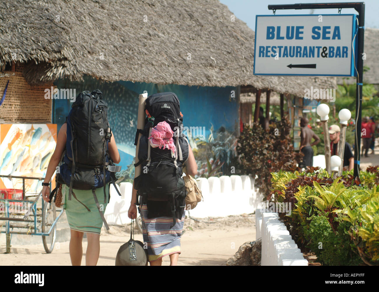 Backpackers arrive on Nungwi beach in Zanzibar. Africa - Stock Image