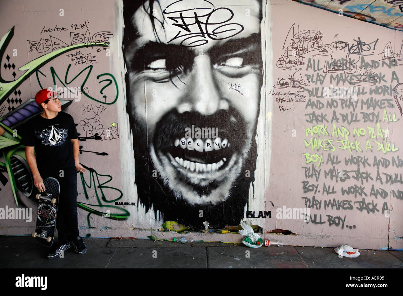 The Shining Grafitti And Skateboarder At The Skateboard Center The South Bank London UK Europe Southbank - Stock Image