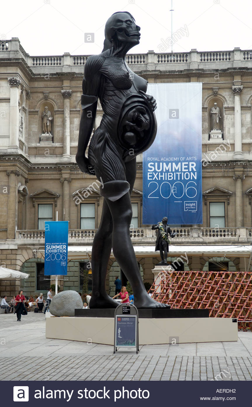 Royal Academy of Arts in London entrance and archway., Burlington House in Picadilly. Sculpture by Damien Hurst - Stock Image