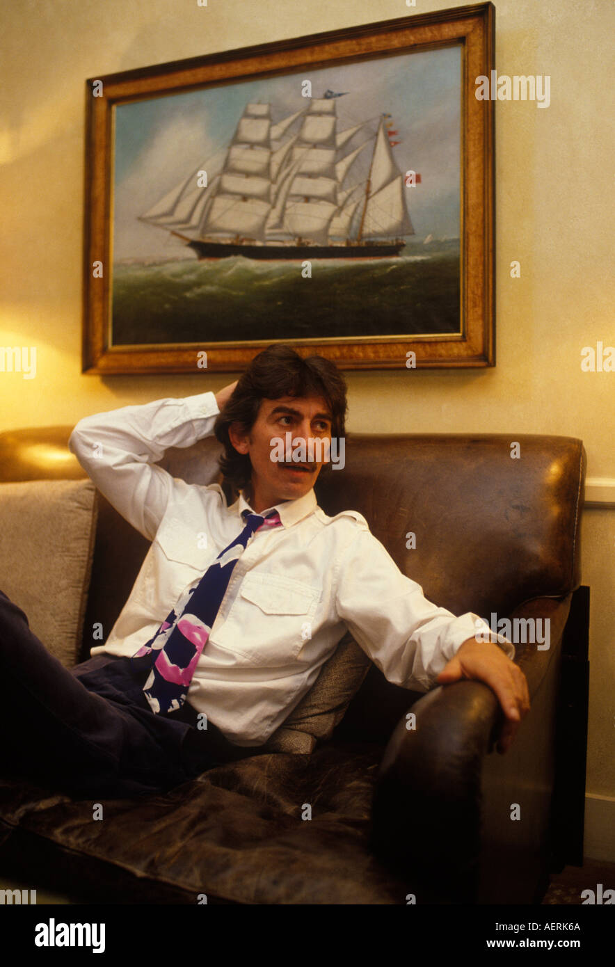 Colour portrait of the former Beatle George Harrison in his London office during an interview 1990s 90s UK HOMER SYKES - Stock Image