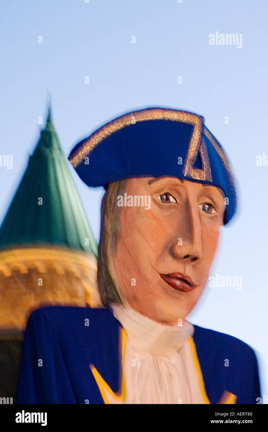 Canada, Quebec City, Fetes de la Nouvelle France, Giant mask in parade - Stock Image