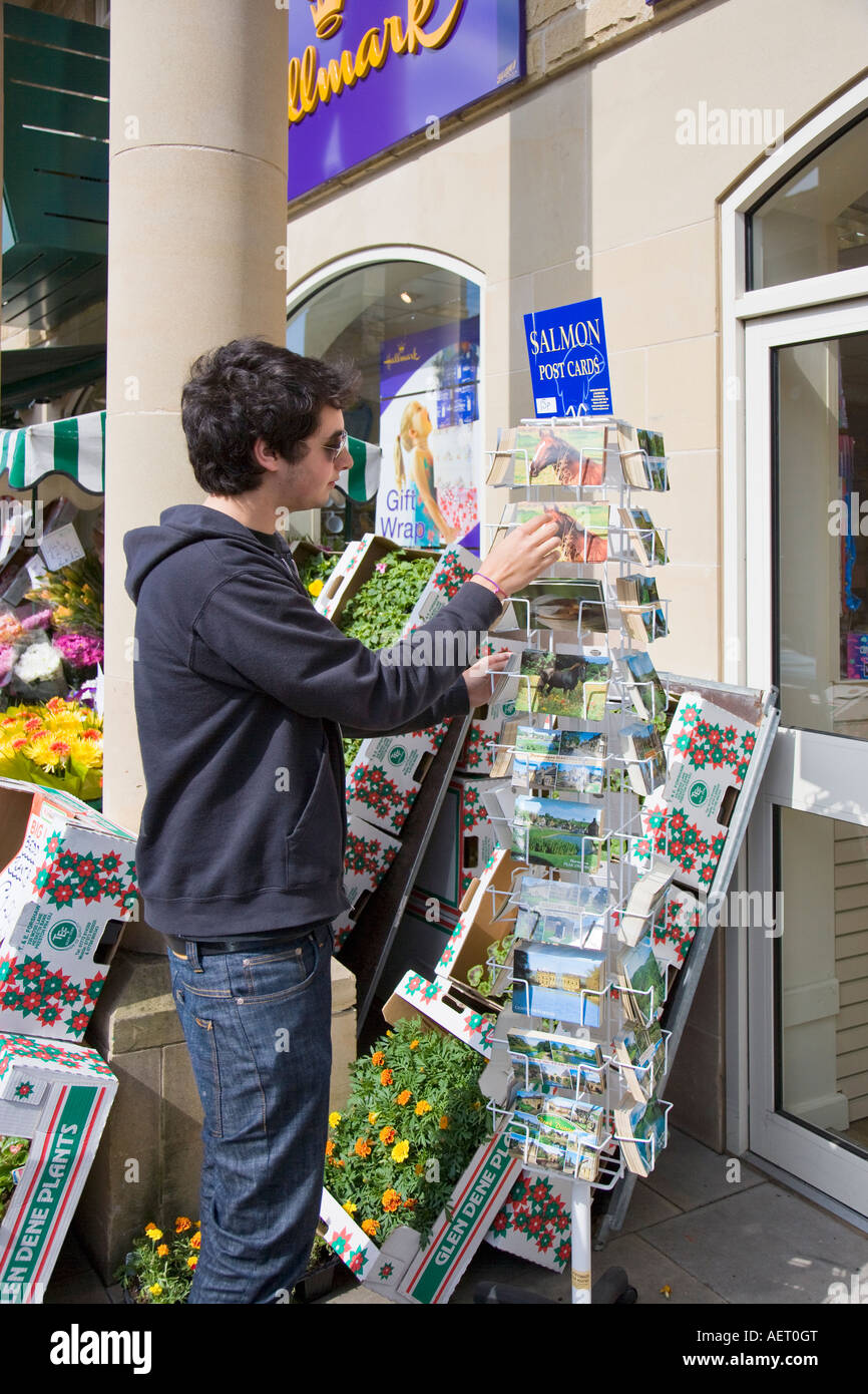 Young Man Looking at Postcards UK Derbyshire Peak District Bakewell - Stock Image