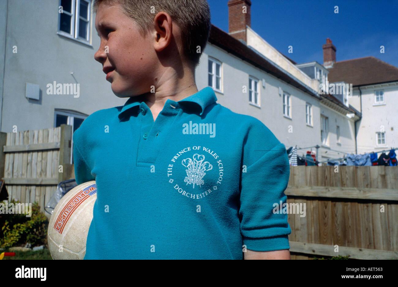 school boy with prince of wales school logo sweatshirt at his house in  Poundbury Dorset - Stock Image