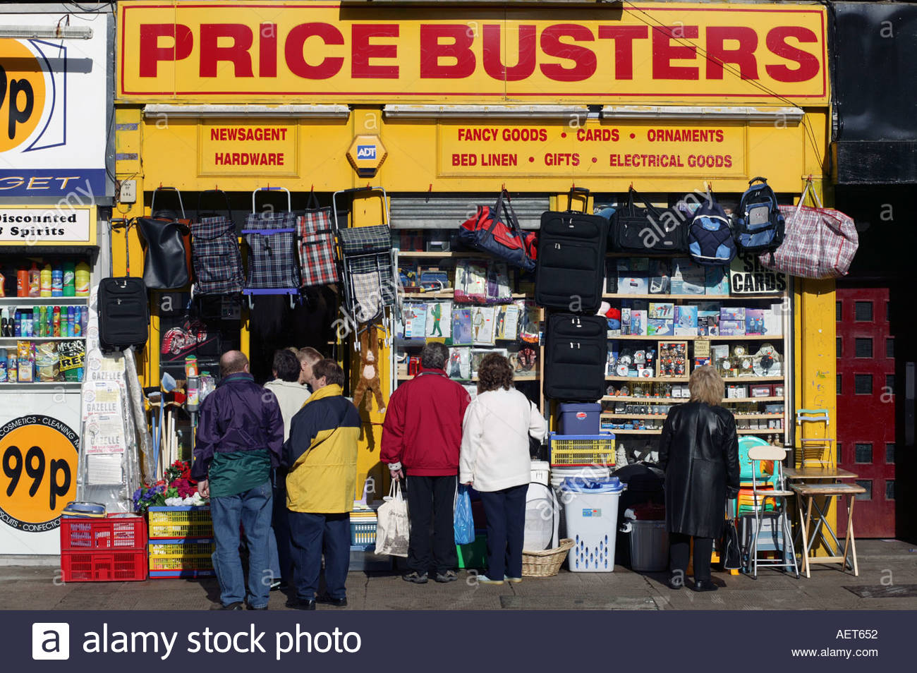 Cheap shops on Dumbarton Road Partick West End of Glasgow poor area with high unemployment Scotland - Stock Image