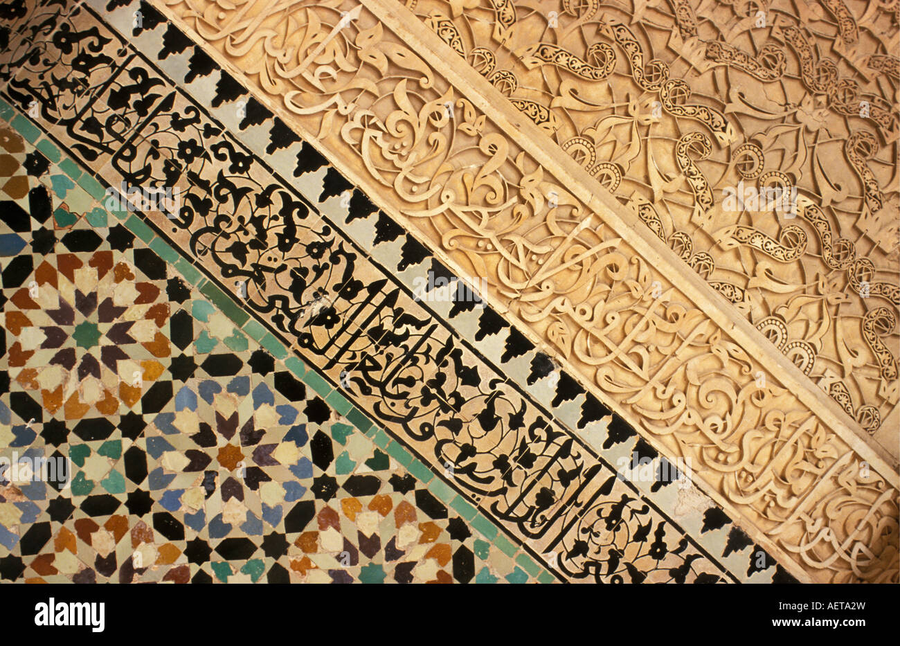 Morocco Marrakech Painted and carved wall of Medersa or Koran school - Stock Image