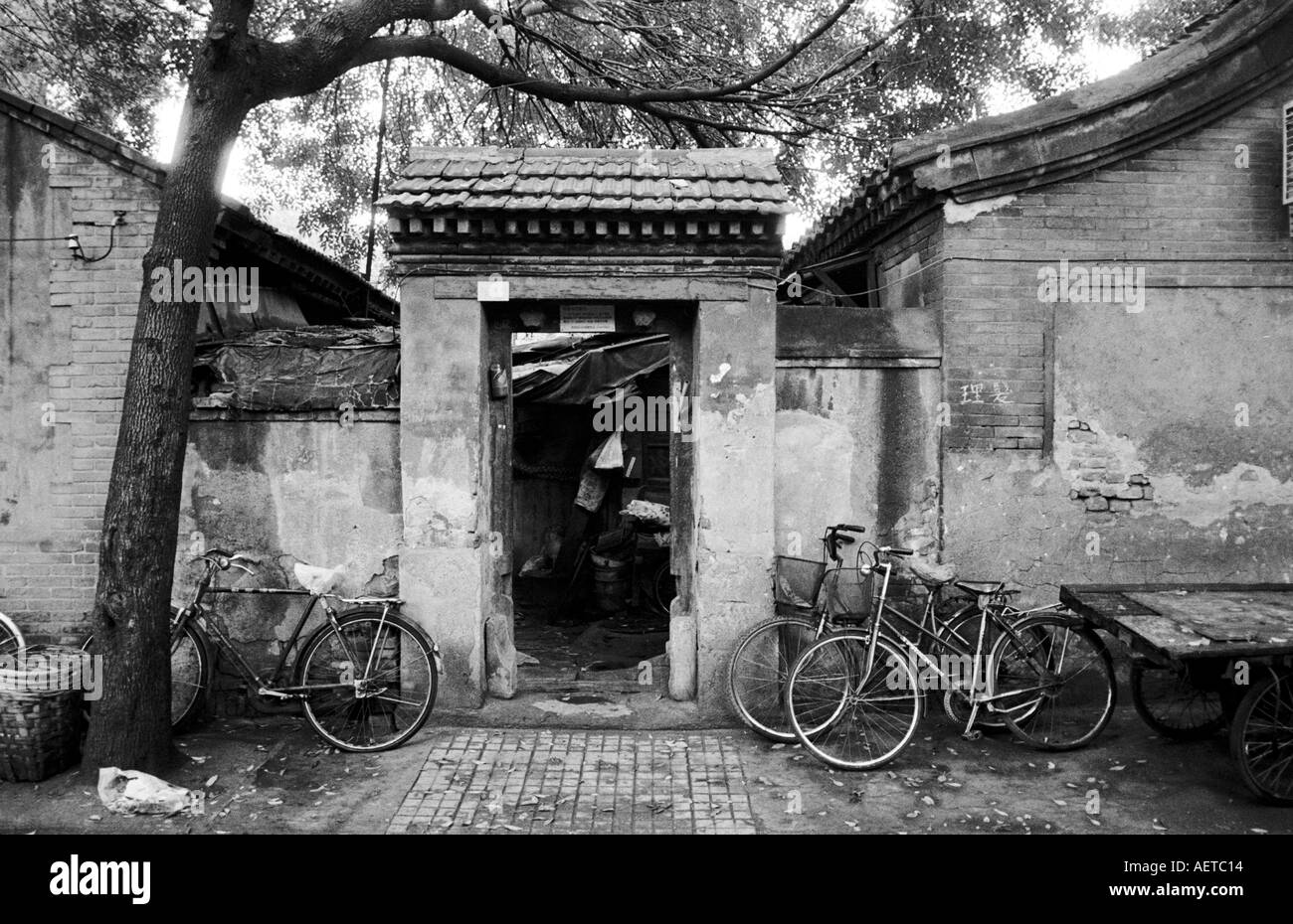 Bicycles parked outside a home in a Beijing hutong 2003 - Stock Image