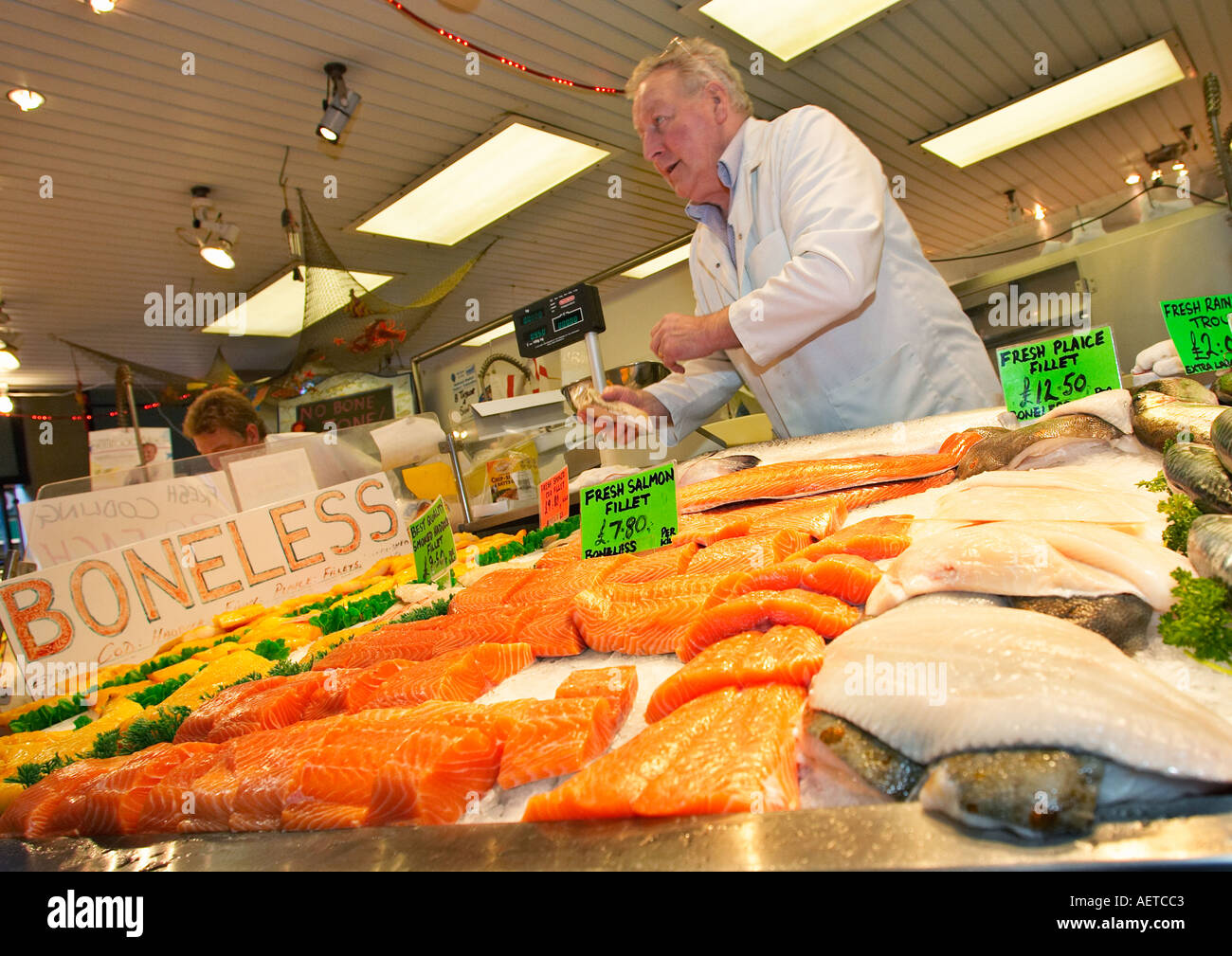 Indoor market stall selling fresh fish England UK - Stock Image
