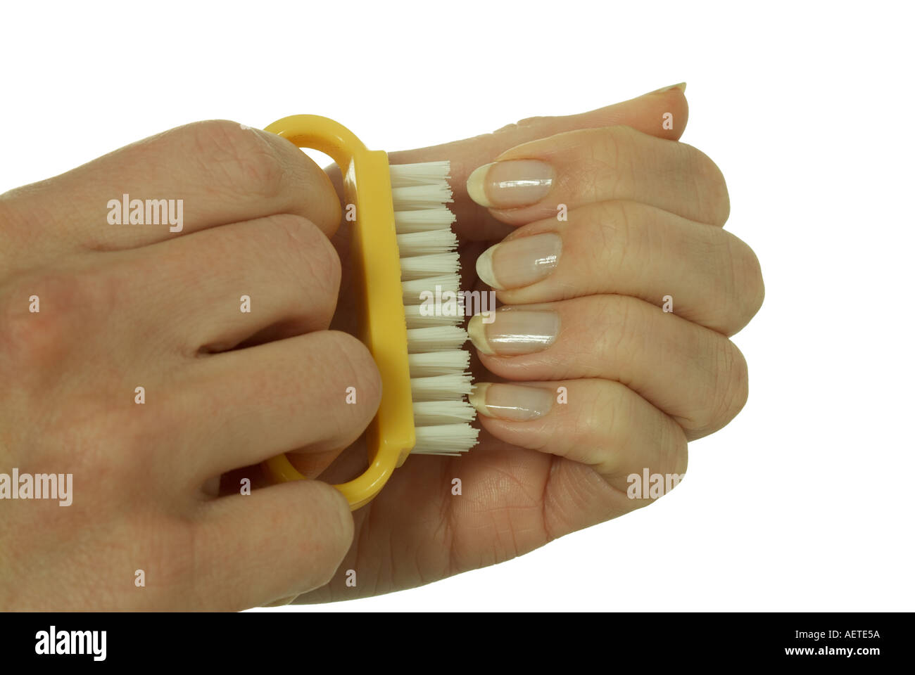 hands with nail brush cleaning nails Stock Photo: 2559577 - Alamy