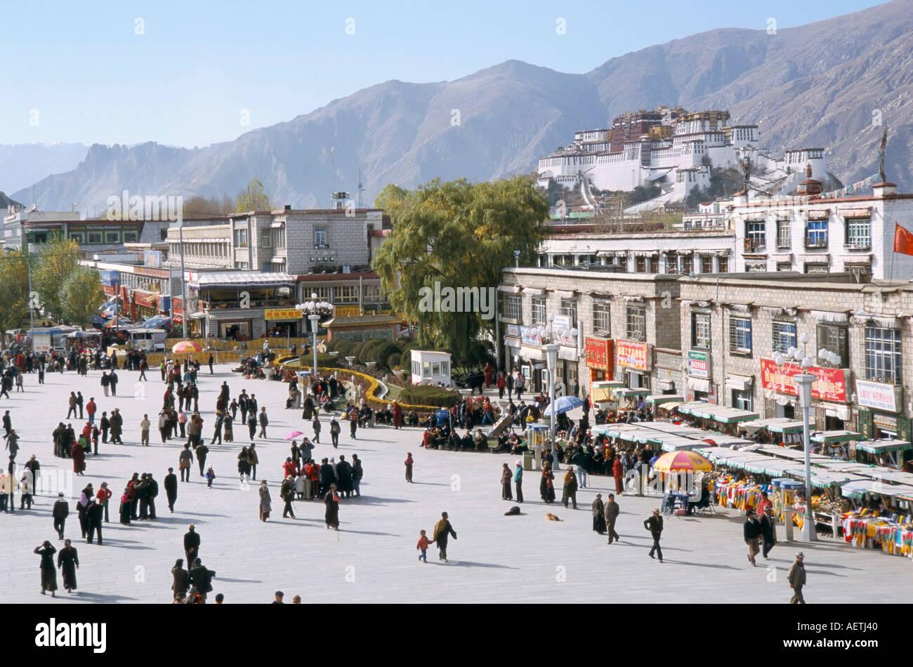 Main square in front of Jokhang Potala palace beyond Lhasa Tibet China Asia - Stock Image