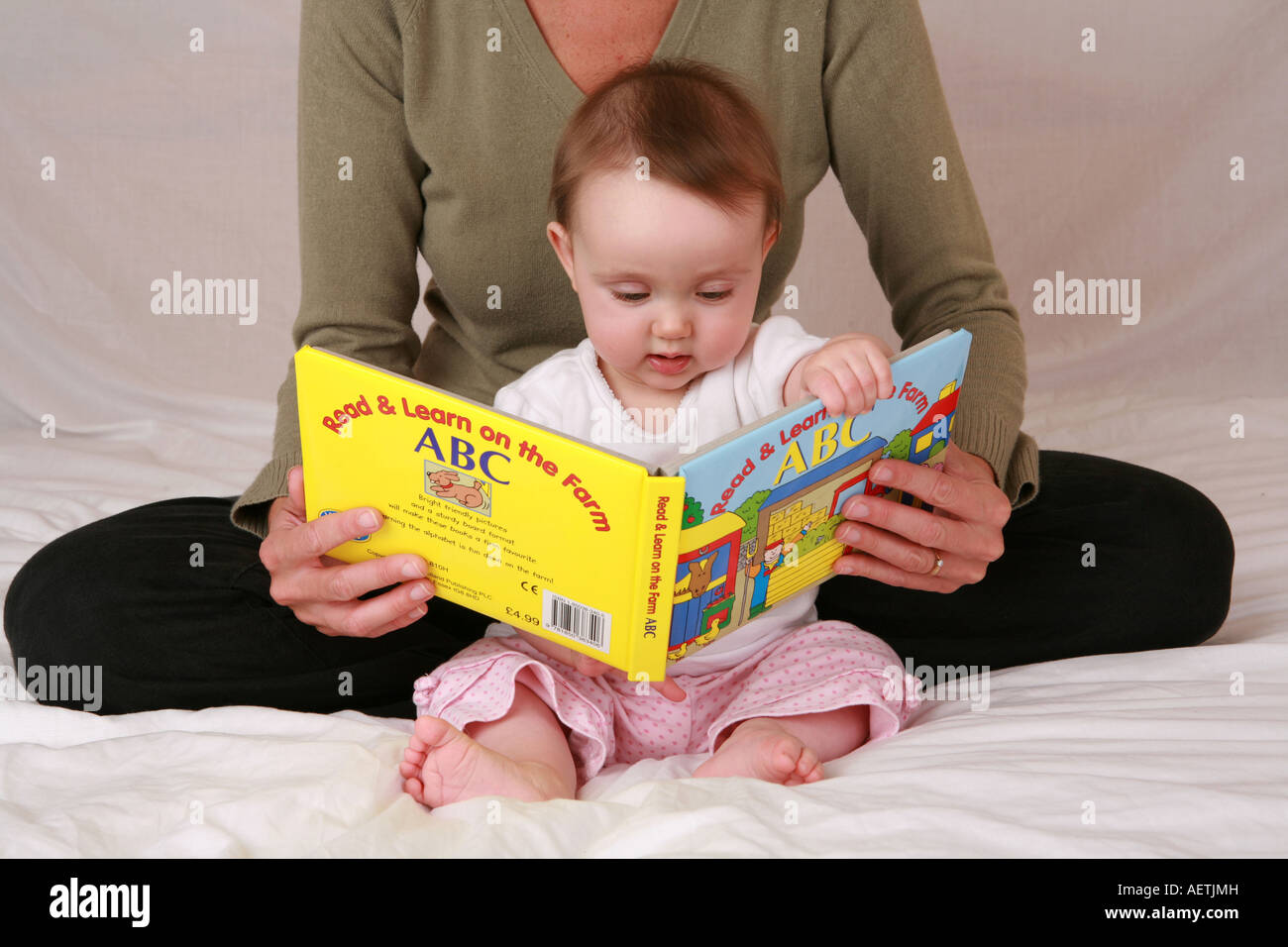 Cute Young Newborn Baby Infant Child Reading First Book With
