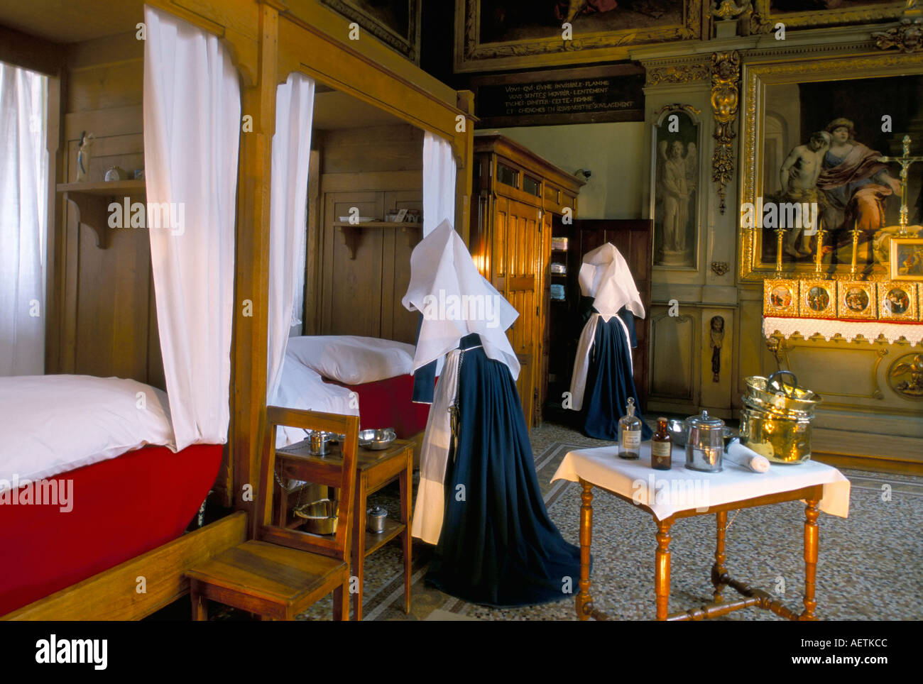 Tableau shows work of the nursing Sisters Hotel Dieu Beaune Burgundy France Europe - Stock Image