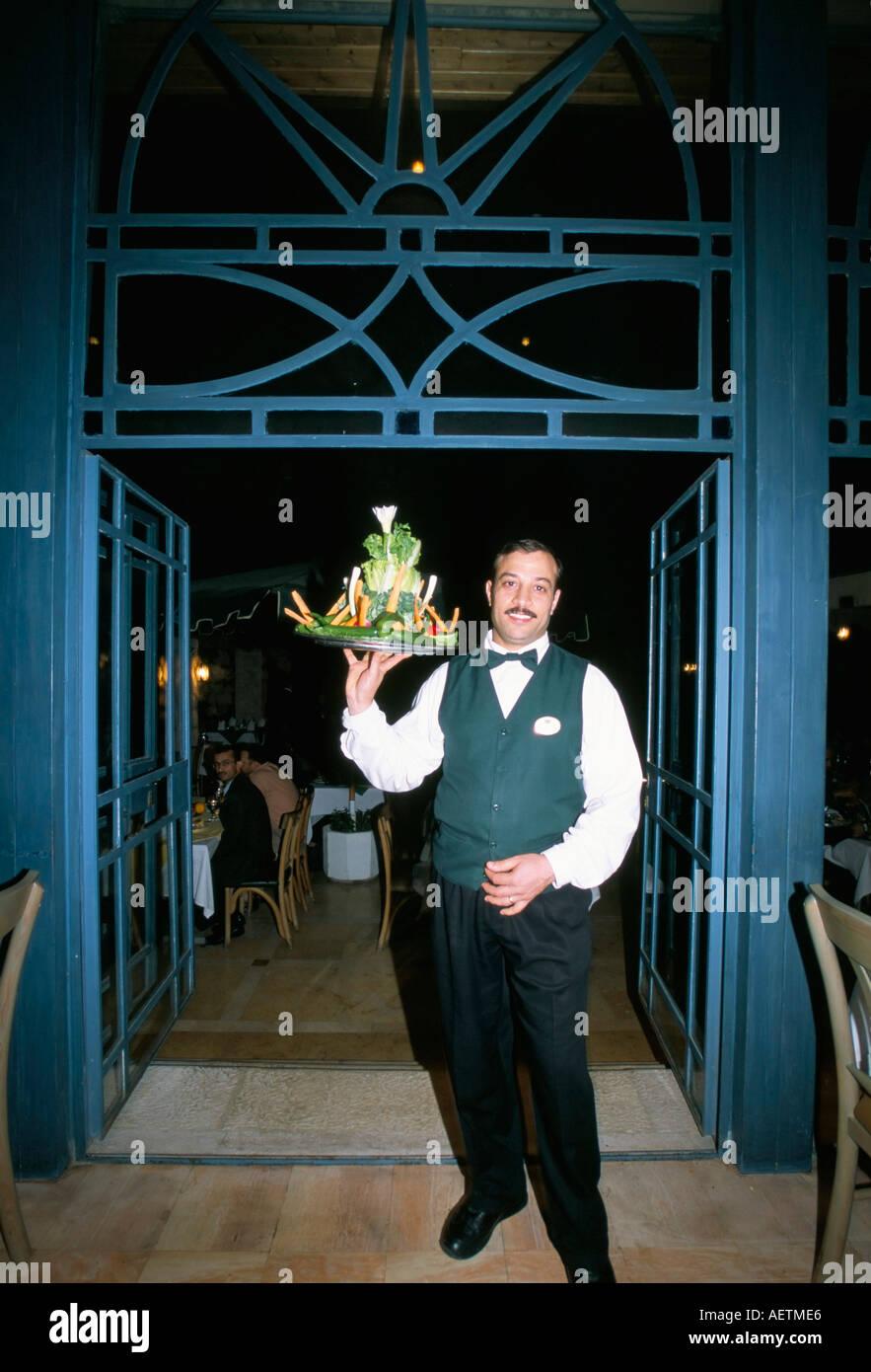 Waiter with signature salad at Fakhr El Din restaurant Amman Jordan Middle East - Stock Image