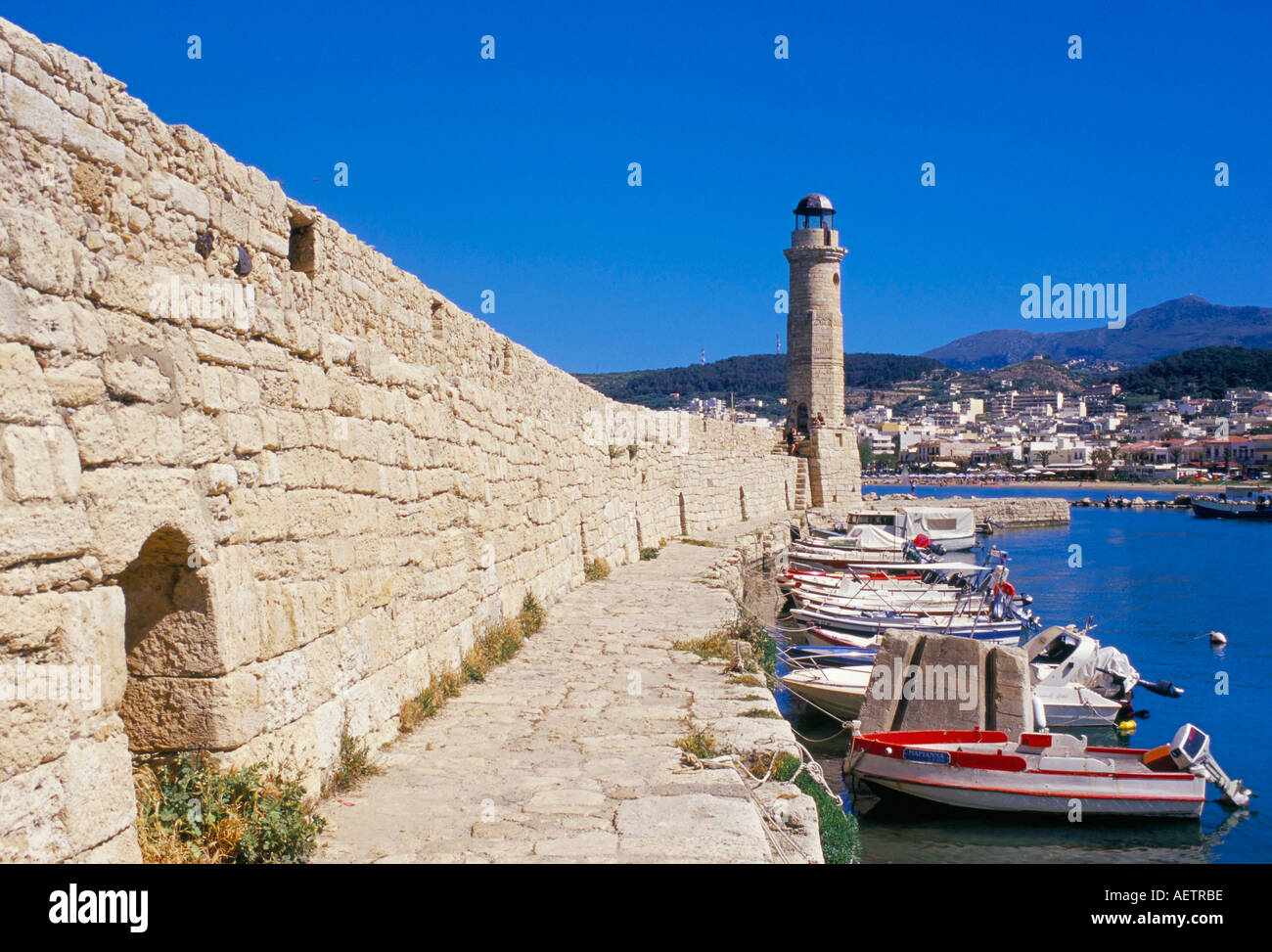 View of old Venetian Rethymo s lighthouse wall and harbours Rethymno Rethymnon island of Crete Greece Mediterraneann Europe - Stock Image