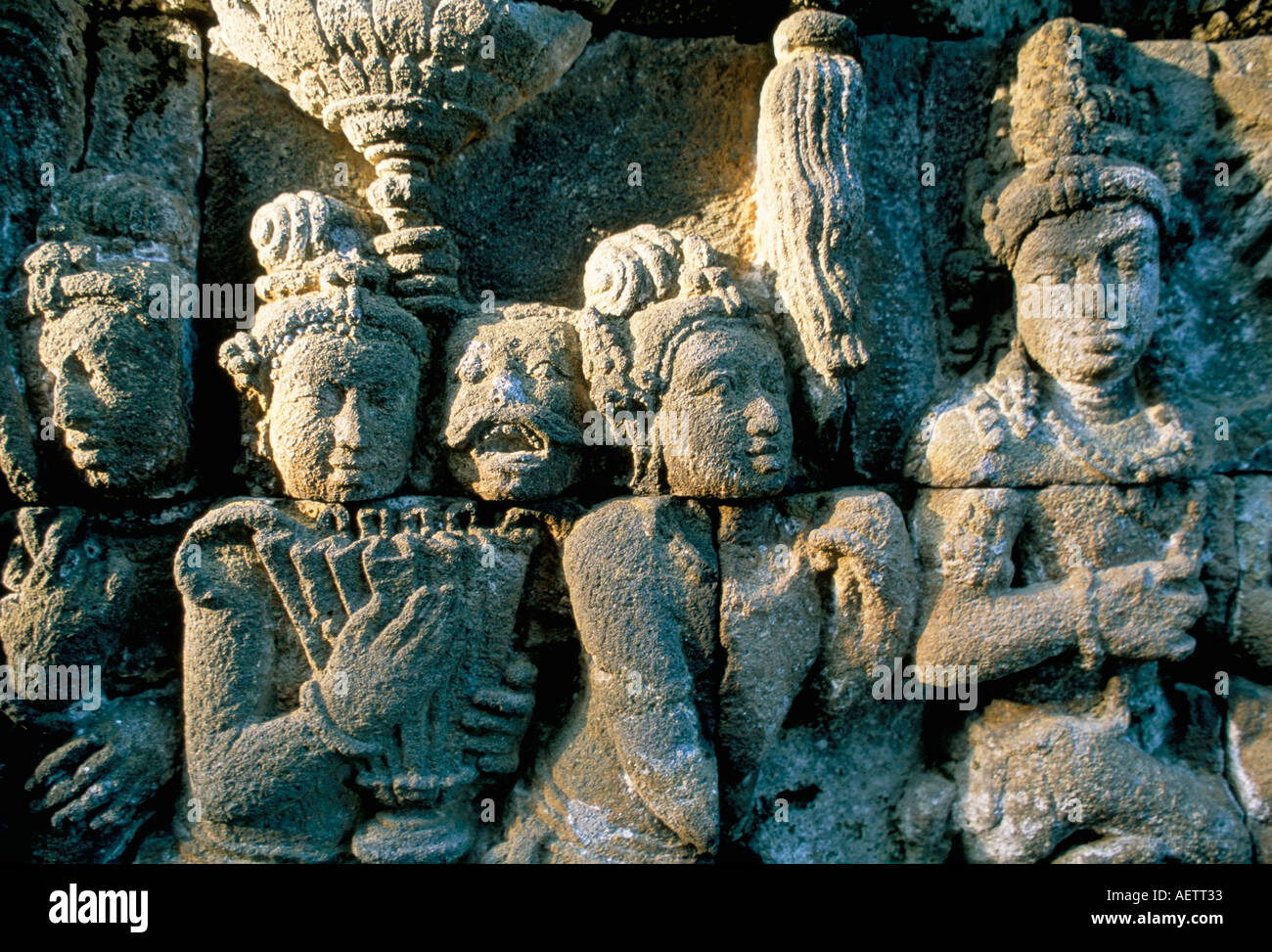 Detail of carved friezes dated from the 8th century AD Buddhist site of Borobudur UNESCO World Heritage Site island of Java Indo - Stock Image