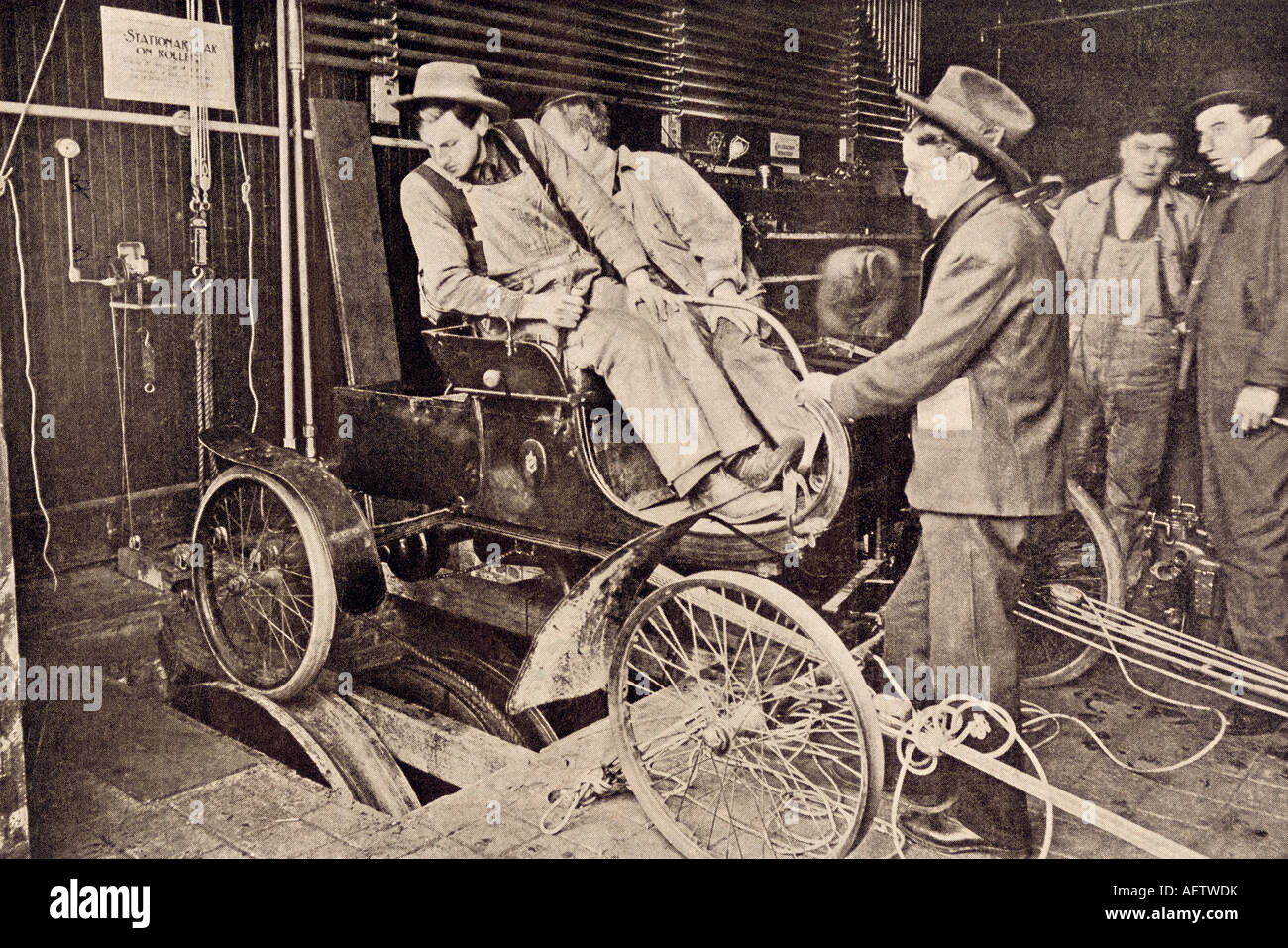 Student driver learning how to start and reverse on an auto school machine New York City 1906. Halftone of a photograph - Stock Image
