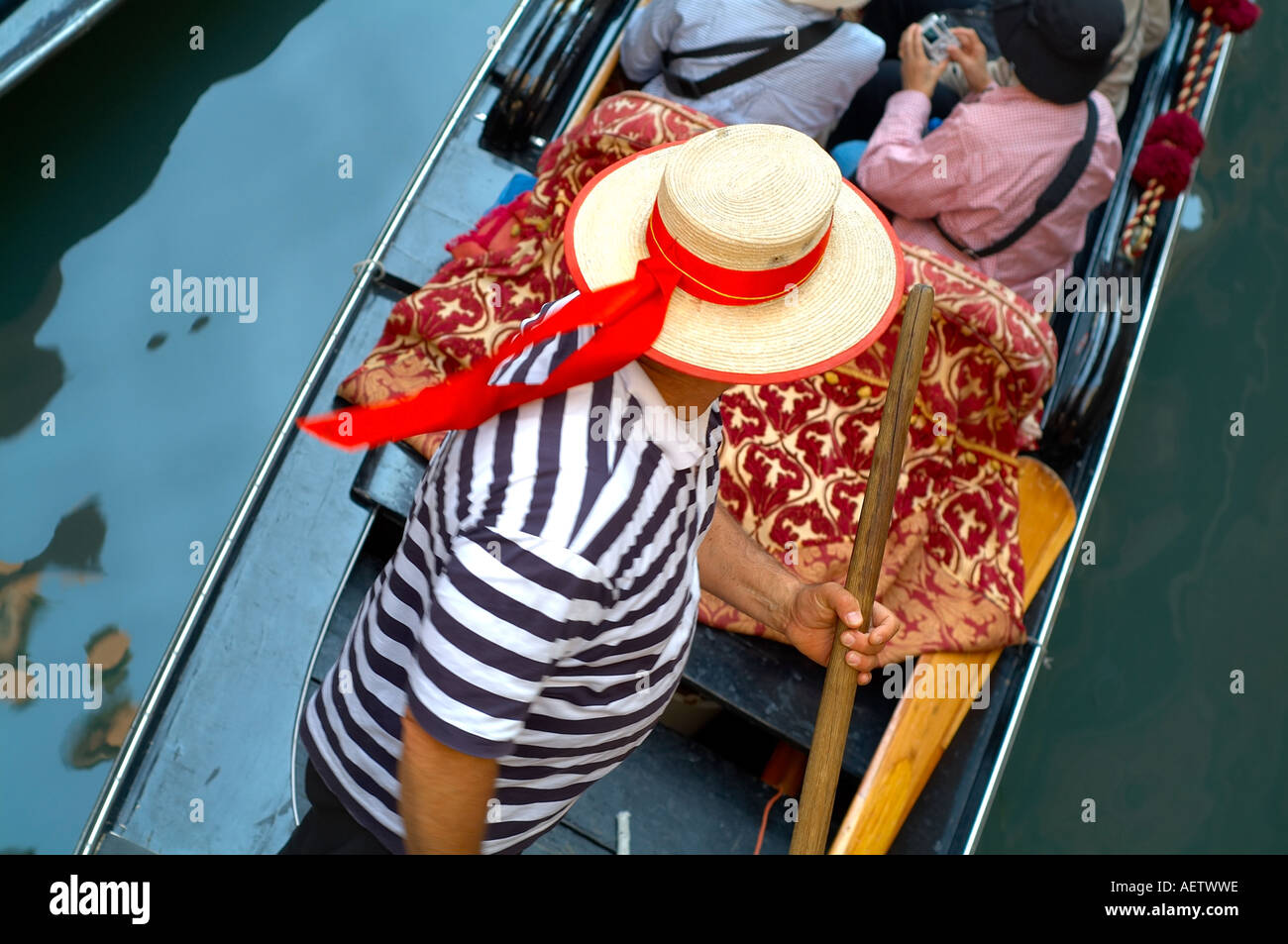 91e58e51abb Gondolier in a gondola wearing a straw hat with red ribbon - Stock Image