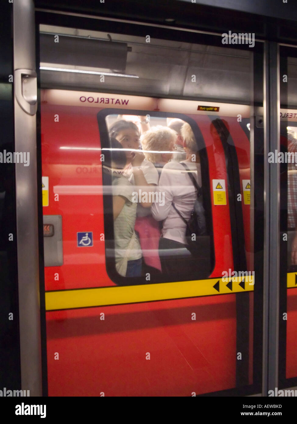 Packed underground train on the Jubilee line , Waterloo Station,London,England - Stock Image