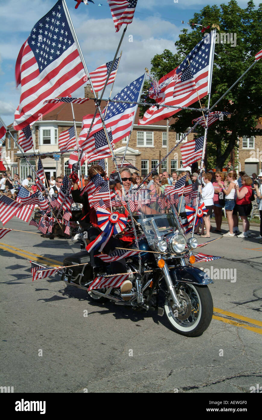 Riding a harley motor cycle with 101 American flags fixed on it