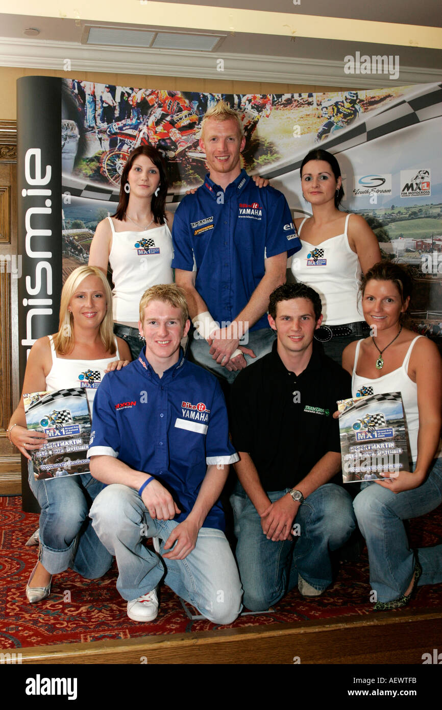 Martin Barr Gordon Crockard and Adam Mckee with PR girls at the launch of the MX1 Grand Prix of Ireland - Stock Image