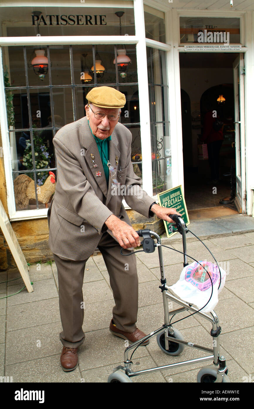 Old man with a zimmer walking frame Stock Photo: 4494621 - Alamy