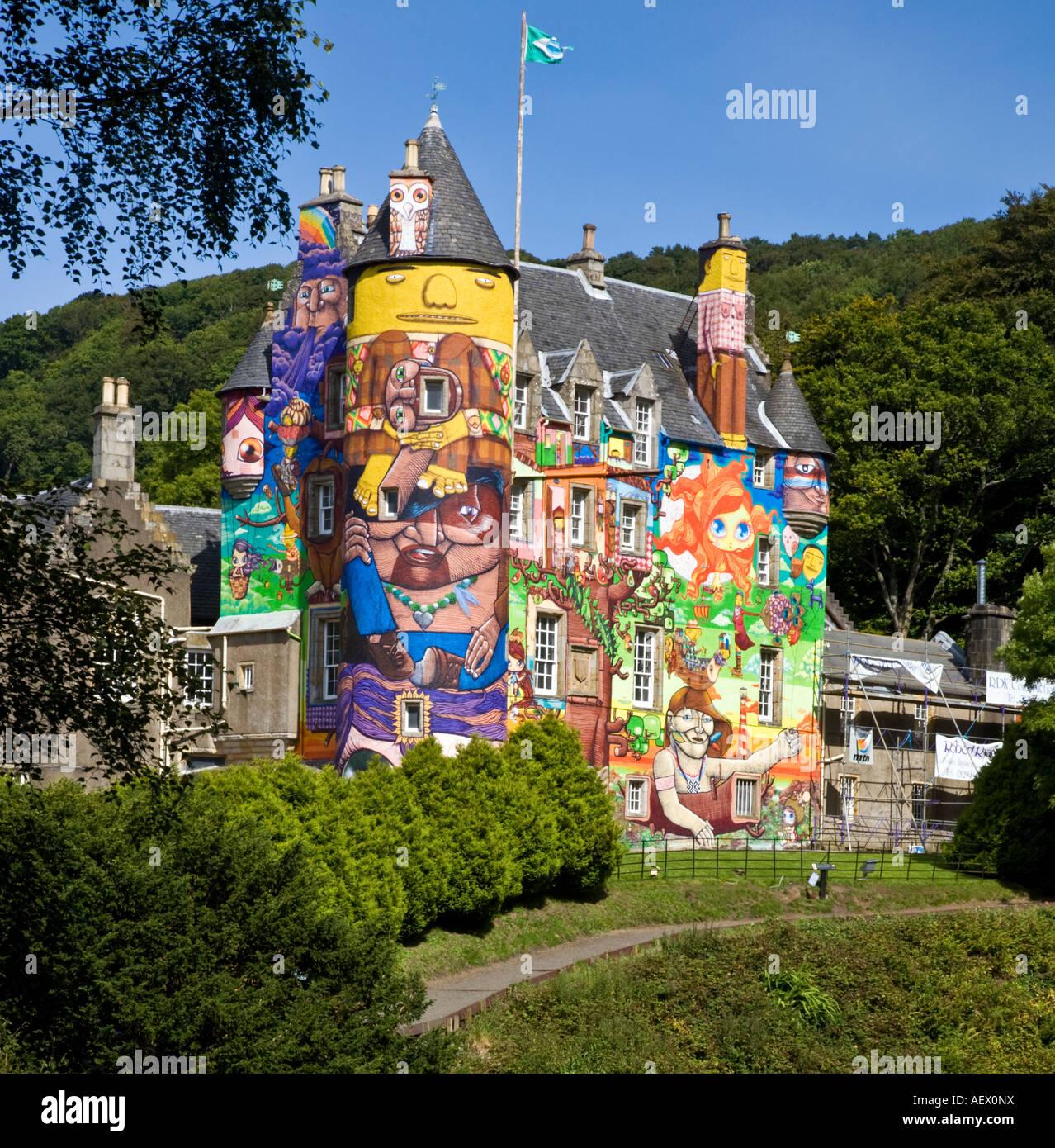 The graffiti project at Kelburn Castle Ayrshire painted by Brazilian artists Os Gemeos Nina Pandolfo and Nunca - Stock Image