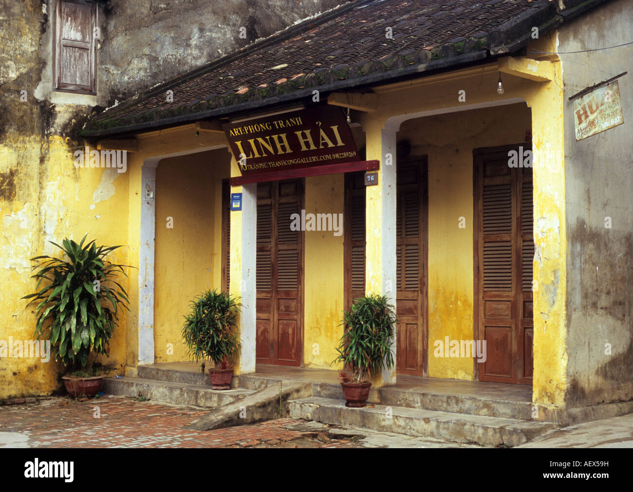Street frontage of an old traditional shophouse Tran Phu St, Hoi An, Viet Nam - Stock Image