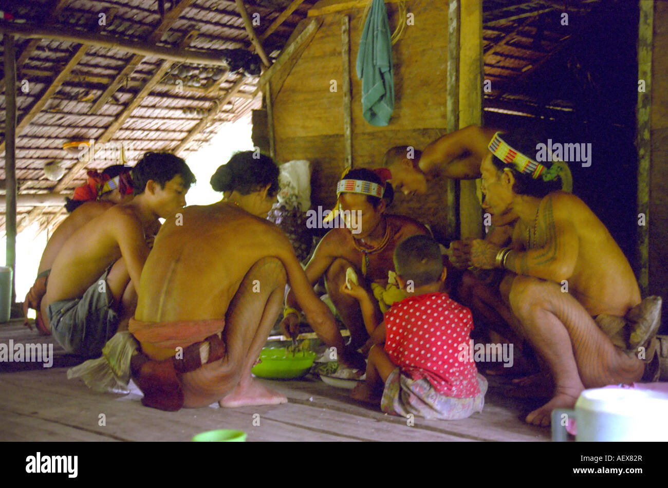 Mentawai family meal on Siberut Island off Sumatra in Indonesia - Stock Image