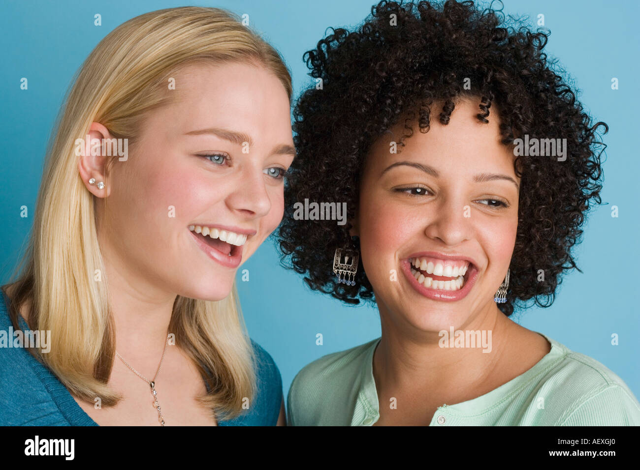 Closeup of two smiling women - Stock Image