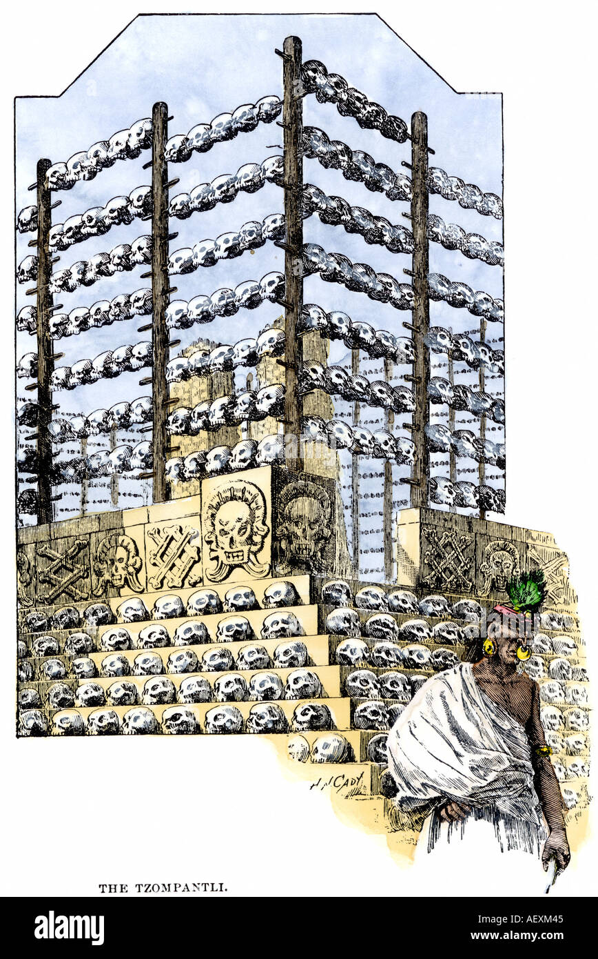 Aztec Tzompantli exhibiting skulls of human sacrifice victims in Tenochtitlan. Hand-colored woodcut - Stock Image