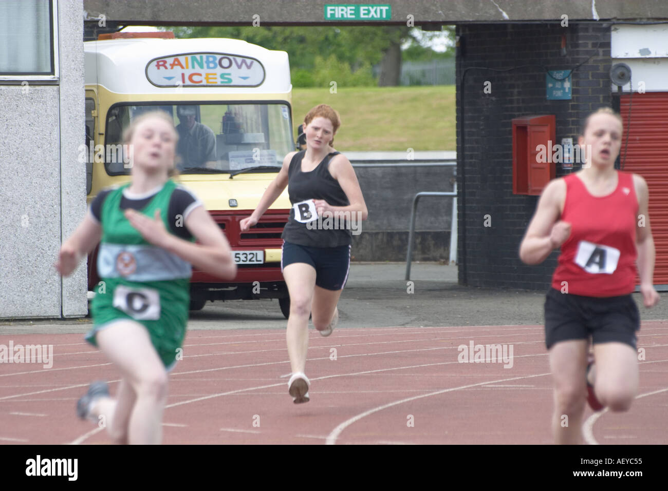 female teenagers running at an athletics competition - Stock Image